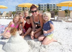 """Building a snowman in the sand from Sweden - Saga (7), Linnea (6), Leo (8), Ebbe (5), Anki (mom), Signe (5).  They all """"really, really love SK beach!"""""""