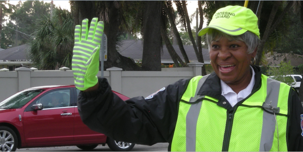 "BEHIND THE SMILE After 22 years working for the school board as a main dish cook at Fruitville elementary school, crossing guard Emma Henry, is still contributing to the lives of Sarasotans. She safely helps three children cross the intersection of Siesta Drive and Osprey every day during the school year. The rest of the time she's there, she brightens peoples day with her contagious smile and friendly wave. Born and raised in Sarasota Emma related, ""When I was a little girl, I always wanted to be a crossing guard."" photos and cutline by Trebor Britt"