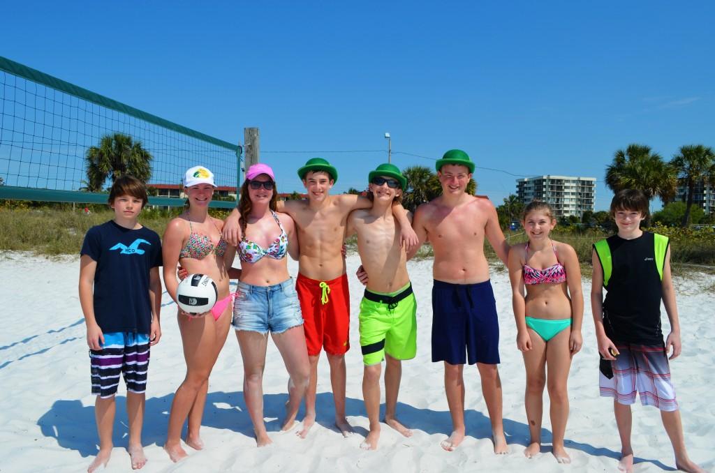 Gabe, Daisy, Hannah, Noah, Matthew, Joshua, Meghan, Josh from Ontario enjoying a game of volleyball on SK beach.