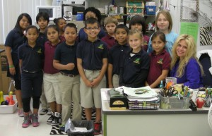 Tuttle Elementary School Teacher of the Year, Tara Greenbaum with her third grade students. Each year, every staff member votes for of a colleague they think should receive the Teacher of the Year honor. The three teachers with the most votes are selected, and a final vote is taken to determine the recipient. photo by Trebor Britt
