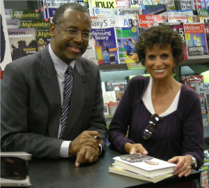 "HUNDREDS ATTEND BOOK SIGNING Siesta Key resident, Sandy Britt with Dr. Ben Carson during a recent book signing at Books-A-Million in Sarasota. He was signing copies of his latest book, ""One Nation: What We Can All Do To Save America's Future""."
