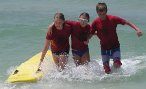 Junior lifeguard program participants Izabela Burns, Morgan Windsor, and Nick Miller.