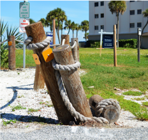 The wooden poles next to the pocket park at Givens Street and Ocean Blvd were hit once again--the last time was just this past February. Photo by Debbie Flessner