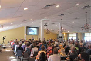 Panelists spoke to a full audience at St. Boniface Episcopal Church. Photo by Roger Drouin.