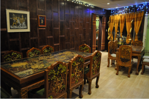 The newly explanded dining area with carved tables can accommodate larger parties.