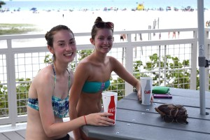livia Goodfriend (20) and Amanda Stambrosky (20) of Sarasota enjoying an ice cold drink on opening day of the new Sunset Pavillion. Former Booker High School graduates, they're on summer break from the University of Florida both majoring in dance. The view from the new Pavillion knocked  their socks off. Although not pictured, they did not have socks on.