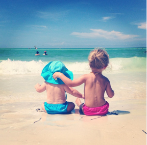 two kids on beach photo