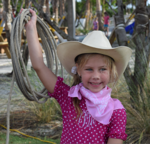 "Hayden White (6) of Lithia, FL near Tampa ready to rope whatever walks by in her 4th ""Kid's Summer Beach Run"". Coming to at least four runs earned her a nifty T-shirt."