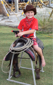 Cayden Emke (7) of Bradenton fully prepared to defend Siesta Beach just before the Western theme beach run. He participated in 8 of the 10 races this summer.