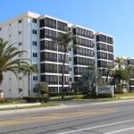 The Crescent Royale condominium complex stands across Beach Road from Siesta Public Beach.