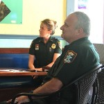 Lt. Debra Kaspar and Capt. Charlie Thorpe of the Sheriff's Office listen to discussion during the March Siesta Key Village Association meeting.