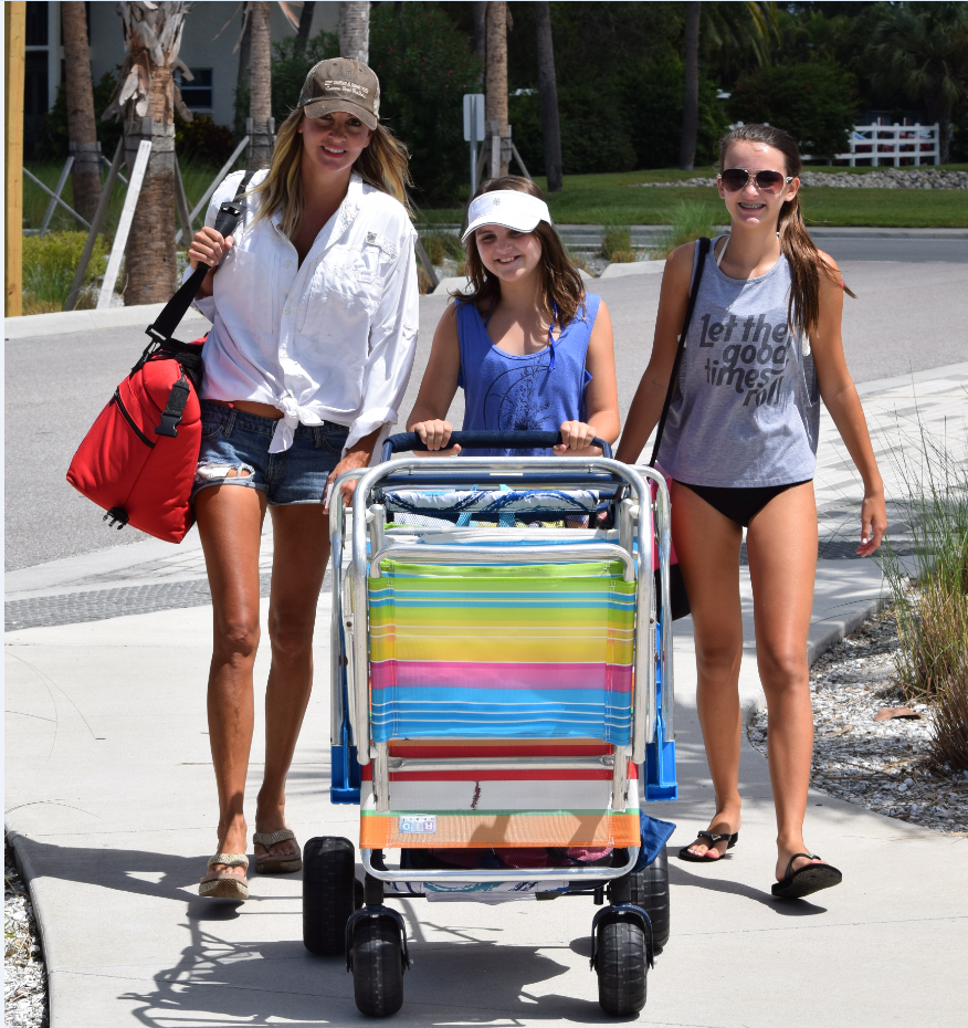 BEACH BOUND       photo by Trebor Britt  Eight year Sarasota resident, Sarah McFadden and her girls Leah (11) and Tiermey (12) lugging their gear to spend a day at fabulous Siesta Beach  relaxing in a  light Gulf breeze. Sarah, formerly a teacher at Sarasota Baptist Preschool is now a stay at home mom.