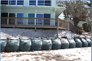 County commissioners direct staff to simplify process for residents to install sandbags to protect homes from severe shoreline erosion